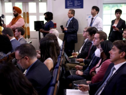 WASHINGTON, DC - JULY 27: Reporters listen as White House Press Secretary Jen Psaki speaks at a daily press briefing in the James Brady Press Briefing Room of the White House on July 27, 2021 in Washington, DC. Psaki fielded questions from reporters on the potential updated CDC guidance on …