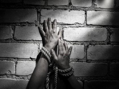 woman hands bound prisoner in room,hands bound