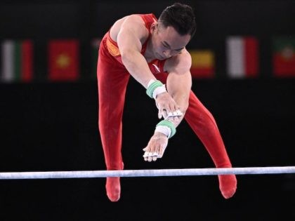 China's Ruoteng Xiao competes in the horizontal bar event of the artistic gymnastics men's all-around final during the Tokyo 2020 Olympic Games at the Ariake Gymnastics Centre in Tokyo on July 28, 2021. (Photo by Lionel BONAVENTURE / AFP) (Photo by LIONEL BONAVENTURE/AFP via Getty Images)