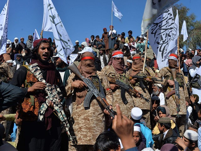 TOPSHOT - Afghan Taliban militants and villagers attend a gathering as they celebrate the peace deal and their victory in the Afghan conflict on US in Afghanistan, in Alingar district of Laghman Province on March 2, 2020. - The Taliban said on March 2 they were resuming offensive operations against …