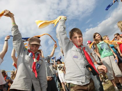 ALMKE, GERMANY - JULY 31: Youth scouts wave with their neckerchief at the camp on July 31, 2010 in Almke near Wolfsburg, Germany. About 5000 young scouts from Germany, Russia, Belgium, Suisse, USA and Italy aged 12 to 20 participate in a camp. Since 1973, the German VCP-Christian Guides and …