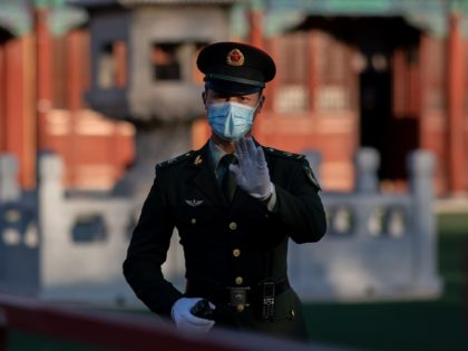 A soldier wearing face masks gestures outside the Forbidden City in Beijing on October 22, 2020, on the eve of the 70th anniversary of Chinas entry into the 1950-53 Korean War. (Photo by NICOLAS ASFOURI / AFP) (Photo by NICOLAS ASFOURI/AFP via Getty Images)