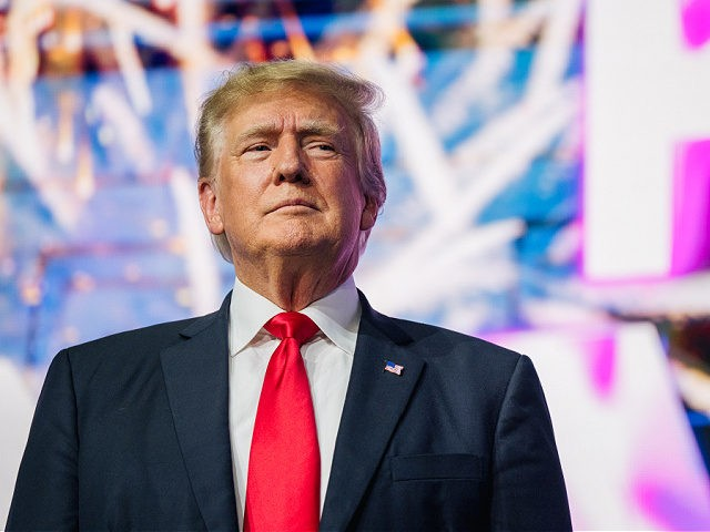 PHOENIX, ARIZONA - JULY 24: Former U.S. President Donald Trump makes an entrance at the Rally To Protect Our Elections conference on July 24, 2021 in Phoenix, Arizona. The Phoenix-based political organization Turning Point Action hosted former President Donald Trump alongside GOP Arizona candidates who have begun candidacy for government …