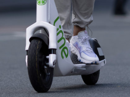 LONDON, ENGLAND - JUNE 07: A member of the public rides an e-scooter on the day of the launch of a pilot program on June 07, 2021 in London, England. Local government have allowed e-scooter operators Lime, Dott and Tier Mobility to run a 12-month trial of scooter rentals in …