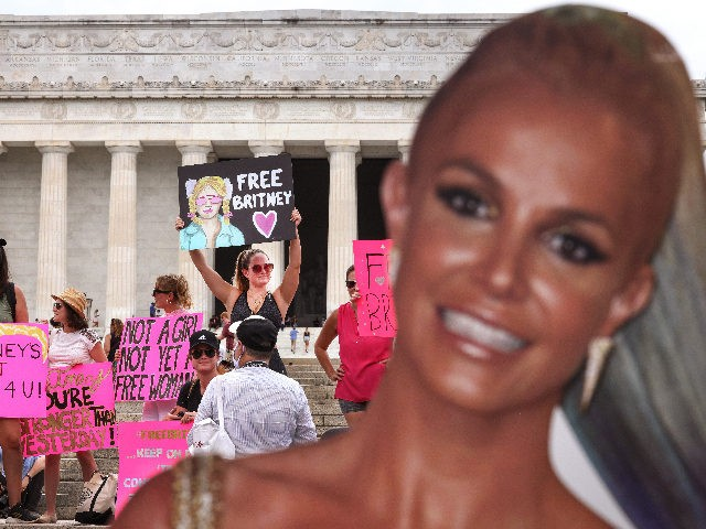 WASHINGTON, DC - JULY 14: Supporters of pop star Britney Spears participate in a #FreeBritney rally at the Lincoln memorial on July 14, 2021 in Washington, DC. The group is calling for an end to the 13-year conservatorship lead by the pop star's father, Jamie Spears and Jodi Montgomery, who …