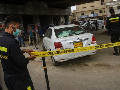 Security officials examine a vehicle that was carrying Chinese nationals in Pakistans port city of Karachi on July 28, 2021, as at least one Chinese national was wounded in a gun attack in the southern Pakistani megacity of Karachi, police said, in the latest assault targeting Chinese citizens in the …