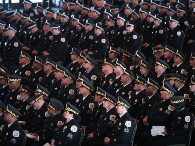 CHICAGO, IL - NOVEMBER 19: Chicago police officers attend a graduation and promotion ceremony at Navy Pier on November 19, 2018 in Chicago, Illinois. More than 350 officers were sworn in at the ceremony, while scores of others were promoted throughout the ranks. (Photo by Scott Olson/Getty Images)