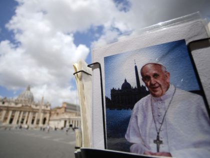 TOPSHOT - A postcard showing Pope Francis is displayed at a souvenirs shop by St. Peter's Square in the Vatican on July 14, 2021. - Pope Francis on July 14, 2021 left the Rome hospital where the 84-year-old pontiff underwent an operation on his colon on July 4. (Photo by …