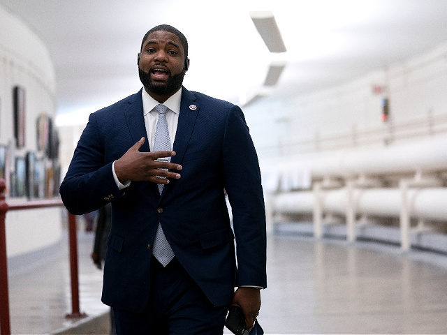 WASHINGTON, DC - JANUARY 12: Rep. Byron Donalds (R-FL) speaks while walking through the Canon Tunnel to the U.S. Capitol on January 12, 2021 in Washington, DC. Today the House of Representatives plans to vote on Rep. Jamie Raskin's (D-MD) resolution calling on Vice President Mike Pence to invoke the …