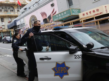 SAN FRANCISCO, CALIFORNIA - MARCH 17: San Francisco police officers patrol Chinatown on March 17, 2021 in San Francisco, California. The San Francisco police have stepped up patrols in Asian neighborhoods in the wake of a series of shootings at spas in the Atlanta area that left eight people dead, …