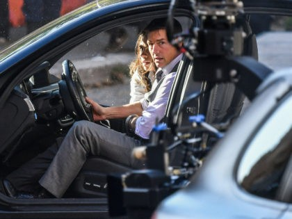 """US actor Tom Cruise and British-US actress Hayley Atwell are pictured during the filming of """"Mission Impossible : Lybra"""" on October 6, 2020 in Rome. (Photo by Alberto PIZZOLI / AFP) (Photo by ALBERTO PIZZOLI/AFP via Getty Images)"""