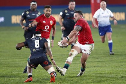 British and Irish Lions prop Rory Sutherland (R) passes the ball during a tour match against the Sharks at Ellis Park in Johannesurg on Wednesday