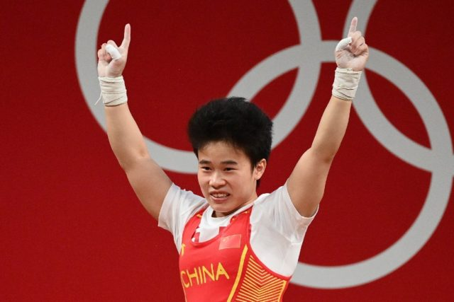 China's Hou Zhihui took the first weightlifting gold of the Games in the women's 49kg