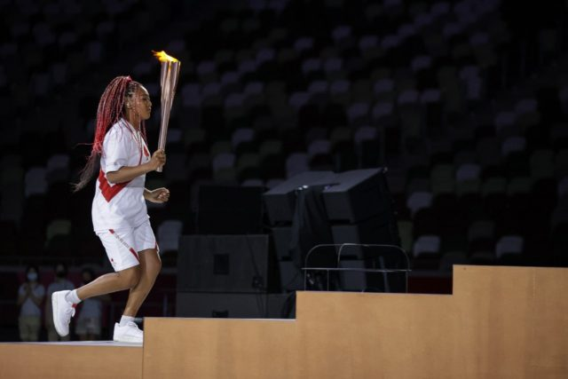 Japanese tennis player Naomi Osaka lit the Olympic cauldron on Friday