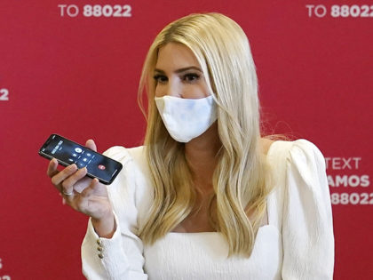 Daughter and adviser of President Donald Trump, Ivanka Trump, middle, works a phone bank at Latinos For Trump headquarters with Arizona Gov. Doug Ducey, left, and a volunteer Wednesday, Sept. 16, 2020, in Phoenix. (AP Photo/Ross D. Franklin)