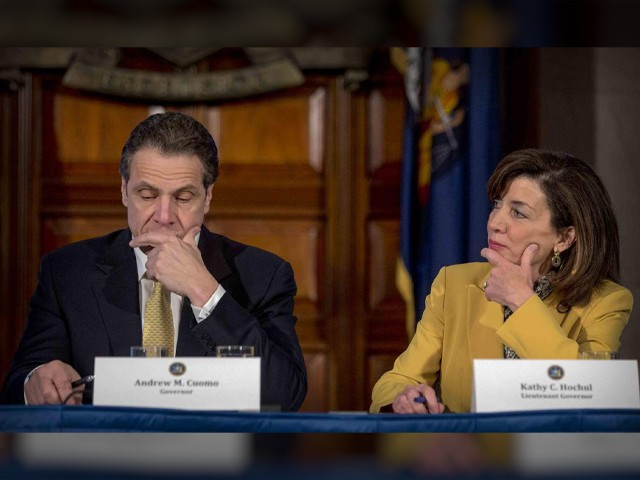 FILE - This photo from Wednesday, Feb. 25, 2015, shows New York Gov. Andrew Cuomo, left, and Lt. Gov. Kathy Hochul during a cabinet meeting at the Capitol in Albany, N.Y. Leaders in the state Assembly announced an impeachment investigation against Cuomo over allegations of sexual harassment, if successful, Hochul would would take over as governor. (AP Photo/Mike Groll, File)