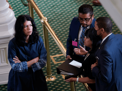 Texas state Sen. Carol Alvarado, D-Houston, talks with staff as she prepares to filibuster Senate Bill 1, a voting bill, at the Texas Capitol, Wednesday, Aug. 11, 2021, in Austin, Texas. (AP Photo/Eric Gay)