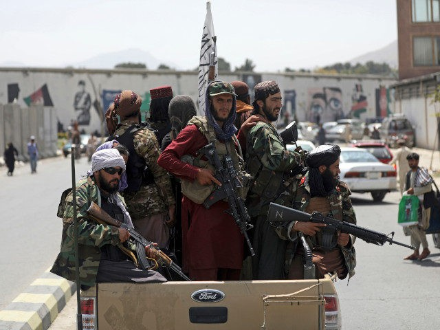 Taliban fighters patrol in Kabul, Afghanistan, Thursday, Aug. 19, 2021. The Taliban celebrated Afghanistan's Independence Day on Thursday by declaring they beat the United States, but challenges to their rule ranging from running a country severely short on cash and bureaucrats to potentially facing an armed opposition began to emerge. …