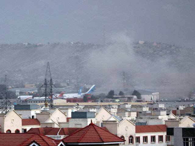 Smoke rises from explosion outside the airport in Kabul, Afghanistan, Thursday, Aug. 26, 2021. The explosion went off outside Kabul's airport, where thousands of people have flocked as they try to flee the Taliban takeover of Afghanistan. Officials offered no casualty count, but a witness said several people appeared to …