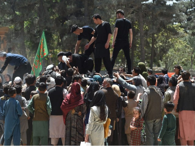 Internally displaced Afghan people, who fled from the northern province due to battle between Taliban and Afghan security forces, gather to receive free food being distributed by Shiite men at Shahr-e-Naw Park in Kabul on August 13, 2021. (Photo by WAKIL KOHSAR / AFP) (Photo by WAKIL KOHSAR/AFP via Getty …