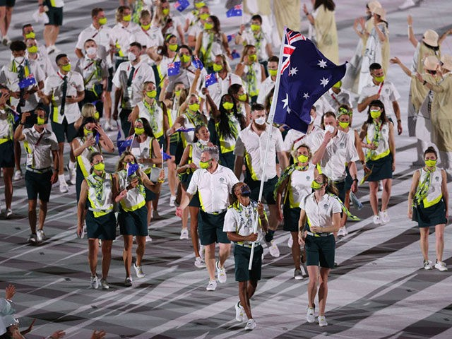 TOKYO, JAPAN - JULY 23: Flag bearers Cate Campbell and Patty Mills of Team Australia lead their team in during the Opening Ceremony of the Tokyo 2020 Olympic Games at Olympic Stadium on July 23, 2021 in Tokyo, Japan. (Photo by Patrick Smith/Getty Images)