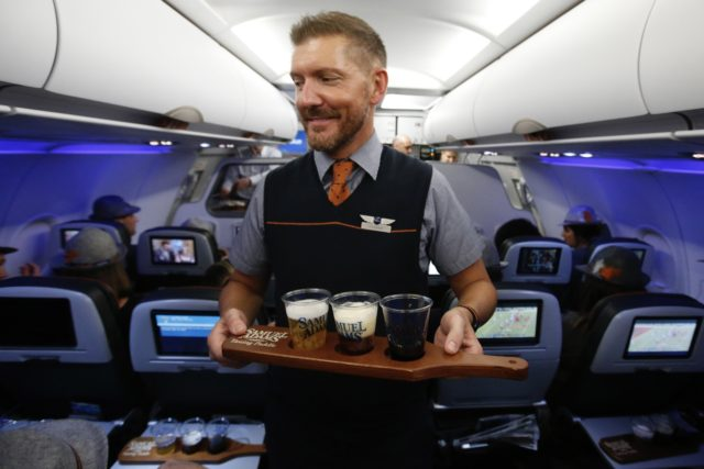 """A flight of Samuel Adams beers from """"Flytoberfest,"""" the first-ever """"Inflight Beer Flight,"""" on a JetBlue plane from New York City to Denver for the Great American Beer Festival®, Thursday, Oct. 5, 2017. (Jason DeCrow/AP Images for JetBlue)"""