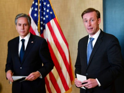 Secretary of State Antony Blinken, left, listens as National Security Adviser Jake Sullivan, right, talks to the media after a closed-door morning session of US-China talks in Anchorage, Alaska on Friday, March 19, 2021. (Frederic J. Brown/Pool via AP)
