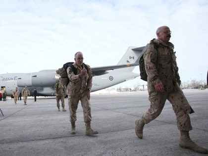 The last Canadian troops to leave Afghanistan, deplane as they return to Canadian soil, in Ottawa, Ontario on March 18, 2014. The last Canadian troops deployed to Afghanistan returned home on Tuesday, bringing an end to Canada's longest ever military engagement. AFP PHOTO/ Cole Burston (Photo credit should read Cole …