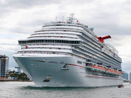 The Carnival Cruise Ship 'Carnival Vista' heads out to sea escorted by a coast guard vessel in the Miami harbor entrance known as Government Cut in Miami, Florida June 2, 2018. (Photo by RHONA WISE / AFP) (Photo credit should read RHONA WISE/AFP via Getty Images)