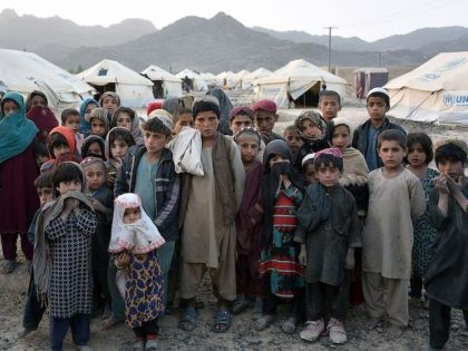 Children pose for photographs in front of their tents at a camp for internally displaced families in Panjwai district of Kandahar province on March 31, 2021. (Photo by JAVED TANVEER / AFP) (Photo by JAVED TANVEER/AFP via Getty Images)