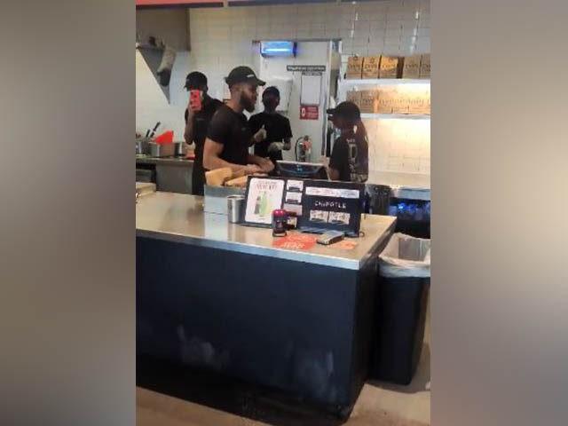 Chipotle worker hurls scissors at customer.