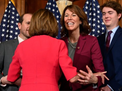 House Speaker Nancy Pelosi of Calif., left, gives a hug to Rep. Cindy Axne, D-Iowa, poses during a ceremonial swearing-in with on Capitol Hill in Washington, Thursday, Jan. 3, 2019, during the opening session of the 116th Congress. (AP Photo/Susan Walsh)