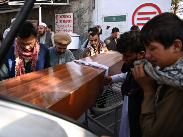 Relatives load in a car the coffin of a victim of the August 26 twin suicide bombs, which killed scores of people including 13 US troops outside Kabul airport, at a hospital run by the Italian NGO Emergency in Kabul on August 27, 2021. (Photo by Aamir QURESHI / AFP) …