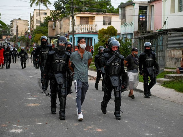 """A man is arrested during a demonstration against the government of President Miguel Diaz-Canel in Arroyo Naranjo Municipality, Havana on July 12, 2021. - Cuba on Monday blamed a """"policy of economic suffocation"""" of United States for unprecedented anti-government protests, as President Joe Biden backed calls to end """"decades of …"""