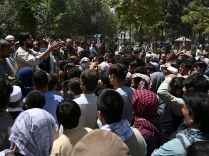 Internally displaced Afghan men, who fled from Kunduz province due to battles between Taliban and Afghan security, gather as they register to recive food at the Shahr-e-Naw Park in Kabul on August 10, 2021. (Photo by WAKIL KOHSAR / AFP) (Photo by WAKIL KOHSAR/AFP via Getty Images)
