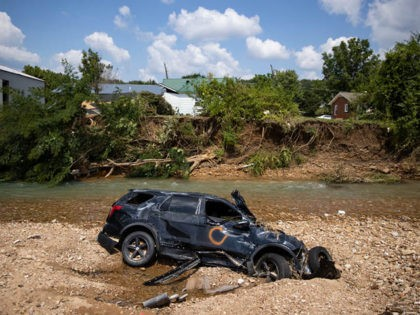 WAVERLY, TN - AUGUST 23: A vehicle destroyed by flooding sits in Trace Creek on August 23, 2021 in Waverly, Tennessee. Heavy rains on Sunday caused flash flooding in the area, leaving at least 22 people dead and several more still missing. (Photo by Brett Carlsen/Getty Images)