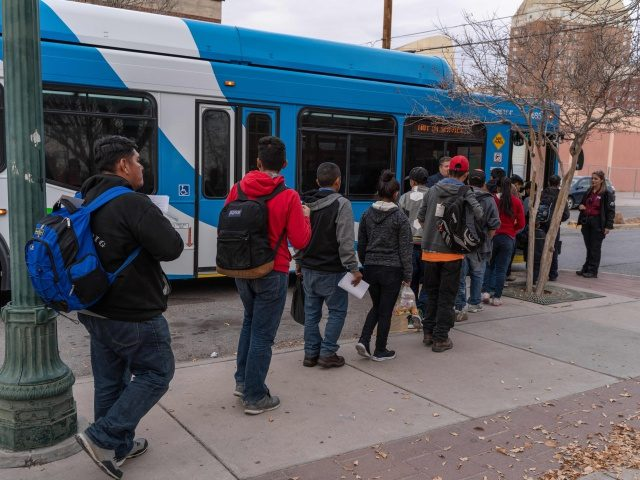 Central American migrants are pictured making their way to El Paso Sun Metro busses after being dropped off in downtown El Paso by Immigration and Customs Enforcement late in the afternoon on Christmas day, December 25, 2018. - About 200 Asylum seekers were dropped off by ICE as part of …