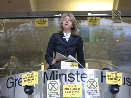 Gail Bradbrook, co-founder of Extinction Rebellion climate action movement, speaks before smashing a window at the front of the building housing the government's Department for Transport in central London on October 15, 2019 as part of Extinction Rebellion's Autumn uprising global protests. (Photo by ISABEL INFANTES / AFP) (Photo by …