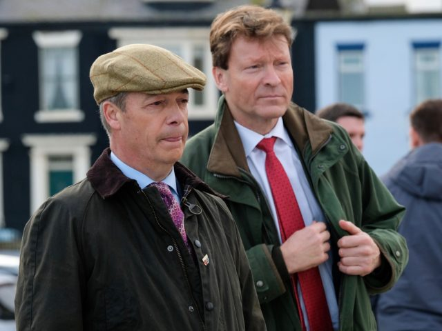 HARTLEPOOL, ENGLAND - NOVEMBER 11: Brexit Party leader Nigel Farage (L) stands with Brexit party chairman and parliamentary candidate for Hartlepool, Richard Tice as they hold a press visit to wartime memorials on Hartlepool Headland during a visit to the town with the Brexit Party general election campaign tour on …