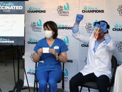 KIRKLAND, WA - DECEMBER 28: Alice Cortez, nurse manager at the Life Care Center of Kirkland, receives a COVID-19 vaccine from CVS pharmacist Matt Talavera on December 28, 2020 in Kirkland, Washington. The Life Care Center of Kirkland, a nursing home, was an early epicenter for coronavirus outbreaks in the …