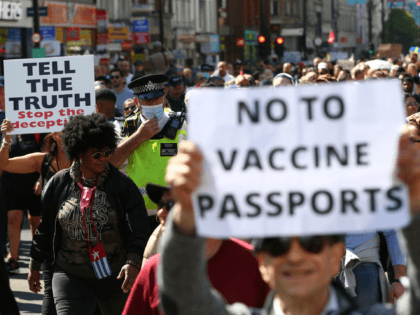 """LONDON, ENGLAND - APRIL 24: A Met Police officer walks amongst protestors during a """"Unite For Freedom"""" anti-lockdown demonstration held to protest against the use of vaccine passports in the United Kingdom, on April 24, 2021 in London, England. The proposed vaccine passports would enable members of the public to …"""