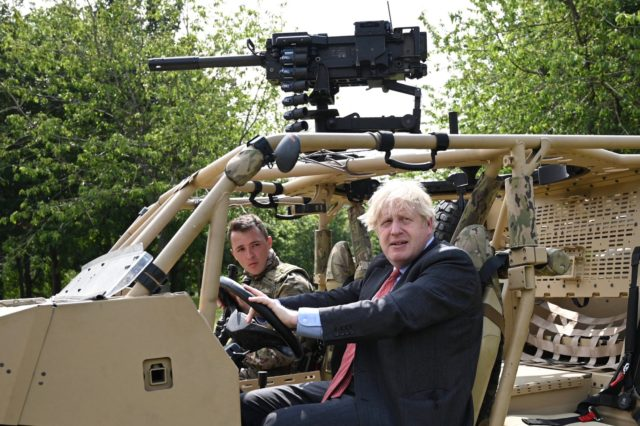Britain's Prime Minister Boris Johnson poses in an armoured vehicle of the new Ranger Regiment during a visit to mark Armed Forces Week, at the Aldershot Garrison in Aldershot, south west England on June 24, 2021. (Photo by DANIEL LEAL-OLIVAS / various sources / AFP) (Photo by DANIEL LEAL-OLIVAS/AFP via …