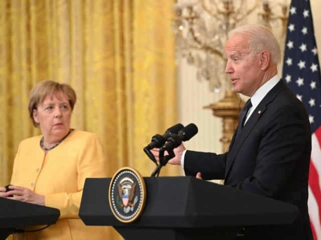 US President Joe Biden and German Chancellor Angela Merkel hold a joint press conference in the East Room of the White House in Washington, DC, July 15, 2021. - Chancellor Angela Merkel on Thursday visited the White House in her diplomatic swan song, a trip underlining how important the veteran …