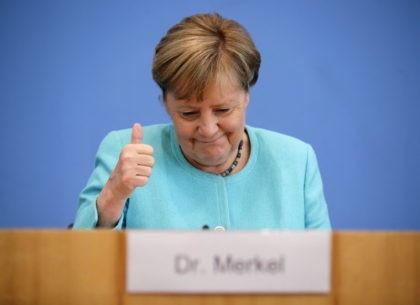 German Chancellor Angela Merkel gives the thumbs up as she holds her annual summer press conference on national and international topics at the house of the Federal Press Conference (Bundespressekonferenz) on July 22, 2021 in Berlin. (Photo by HANNIBAL HANSCHKE / POOL / AFP) (Photo by HANNIBAL HANSCHKE/POOL/AFP via Getty …