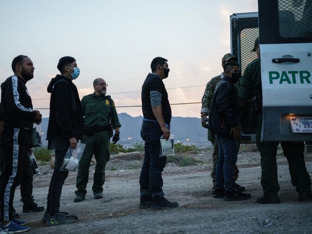 Migrants caught crossing the US-Mexico border are loaded into a transport van by US Border Patrol agents in Sunland Park, New Mexico on July 22, 2021. - Many advocates from national organizations urge President Biden to end Title 42 expulsions, a public health order issued in March 2020 by the …