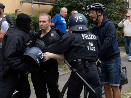 German police arrest a participant of an anti-lockdown protest in Berlin on August 1, 2021. - Berlin police clashed with Covid sceptics on August 1 after hundreds of them took to the streets despite a court-ordered protest ban over concerns participants would not respect rules on mask-wearing and social distancing. …