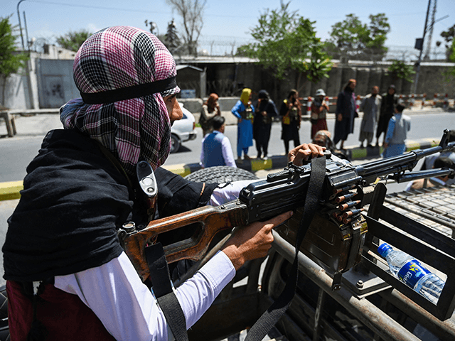 A Taliban fighter mans a machinegun on top of a vehicle as they patrol along a street in Kabul on August 16, 2021, after a stunningly swift end to Afghanistan's 20-year war, as thousands of people mobbed the city's airport trying to flee the group's feared hardline brand of Islamist …