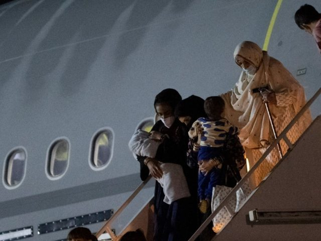 Passengers evacuated from Afghanistan disembark from a British Royal Air Force (RAF) Airbus KC2 Voyager aircraft, after landing at RAF Brize Norton station in southern England on August 24, 2021. - Britain said on August 23 it would urge the United States to extend an end-of-the-month deadline for evacuations from …
