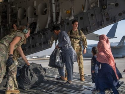 U.S. Air Force loadmasters and pilots assigned to the 816th Expeditionary Airlift Squadron, load passengers aboard a U.S. Air Force C-17 Globemaster III in support of the Afghanistan evacuation at Hamid Karzai International Airport (HKIA), Afghanistan, Aug. 24, 2021. (U.S. Air Force photo by Master Sgt. Donald R. Allen)