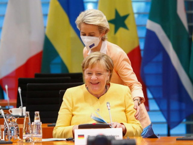 German Chancellor Angela Merkel (L) is greeted by European Commission President Ursula von der Leyen at the G20 Compact with Africa (CwA) meeting at the Chancellery in Berlin on August 27, 2021. (Photo by MICHELE TANTUSSI / POOL / AFP) (Photo by MICHELE TANTUSSI/POOL/AFP via Getty Images)